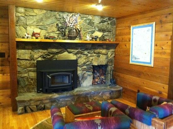 Good Medicine Lodge : One of many fireplace/sitting areas