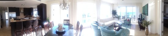 The Venetian on Grace Bay: Panorama of 401's hall/entry, kitchen, dining, living room, partial balcony.