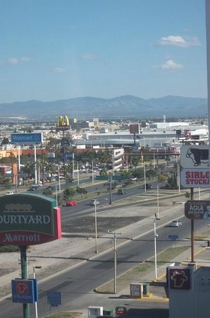Holiday Inn Express San Luis Potosi: View down street. Wallmart, KFC nearby