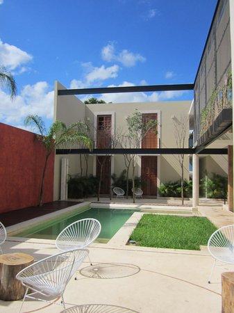 Koox Casa de las Palomas Boutique Hotel: Small pool, our room beyond it