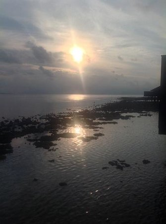 Lily Beach Resort & Spa: view from decking of the sun setting