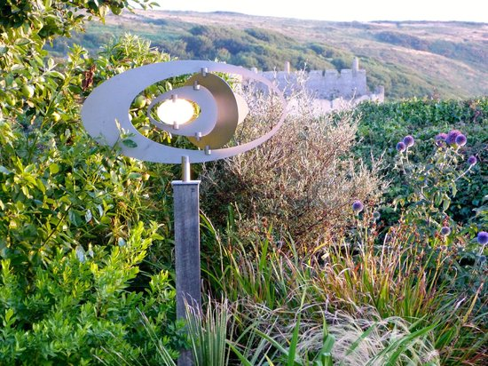 Manorbier Bed and Breakfast: The Wind Elipse Sculpture, with Manorbier Castle in the background