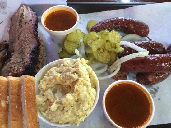 Louie Mueller Barbecue: The big haul - brisket, chipotle sausage, sauce, pickles, onions, bread and potato salad
