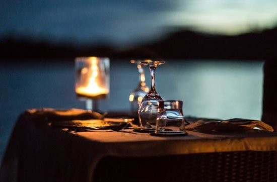 Tavanipupu Private Island Resort: Simple pleasures: wine, a meal and a sunset.