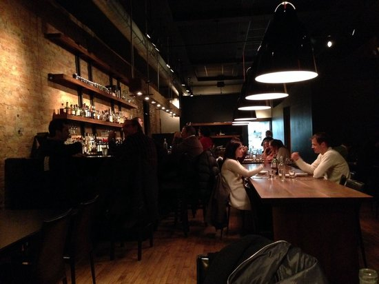 Black Market : Intimate setting, communal tables and a large bar.  Very cool setting, but it does not seat many