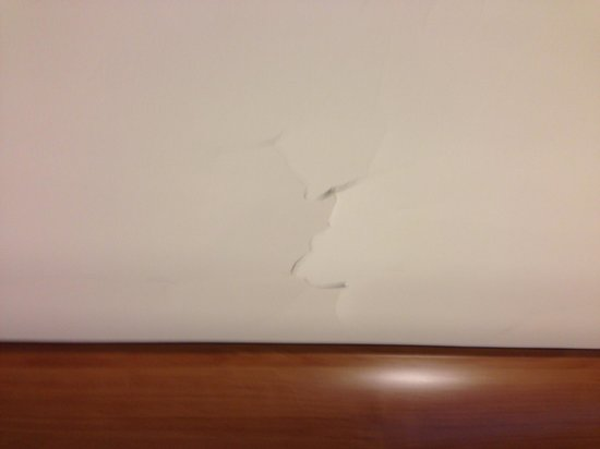 """New York Hilton Midtown: This is the ceiling in our """"renovated"""" room.  Plaster falling apart."""