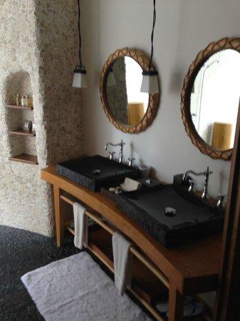 Constance Moofushi: The hald outdoor bathroom