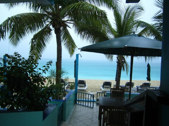 The Azure Hotel: Common Patio outside beachfront rooms on a rainy day
