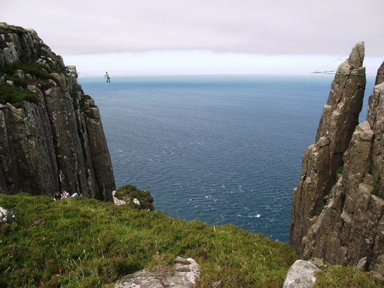 Murlough Bay and Fair Head: A slackliner between two of Fair Head's cliffs
