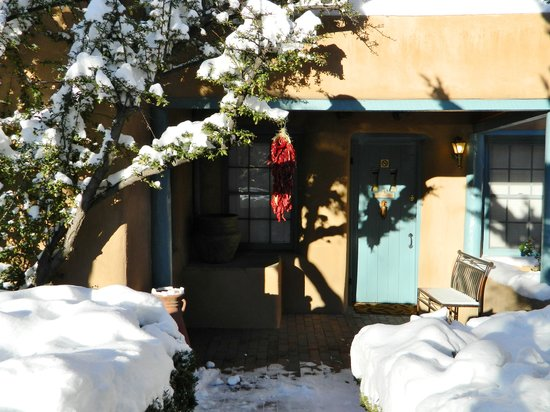 Pueblo Bonito Bed and Breakfast Inn: Winter in Santa Fe is romantic, beautiful and cozy warm in our two foot thick adobe guest rooms.