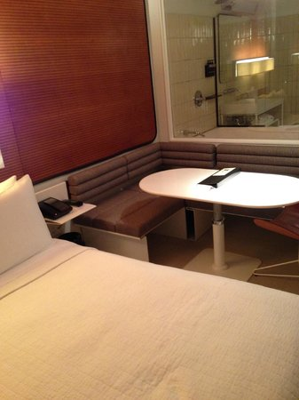 The Standard, High Line: Bed, seating area and bathroom (Standard Queen Corner Room)