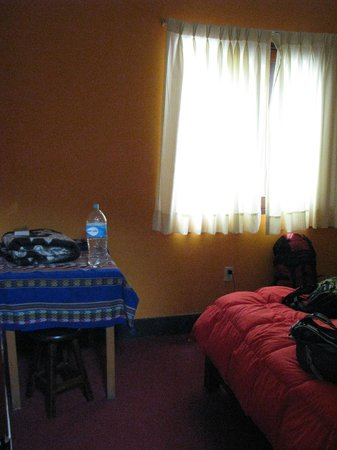 Backpacker's Family House: Table, stool, and bed in room 7