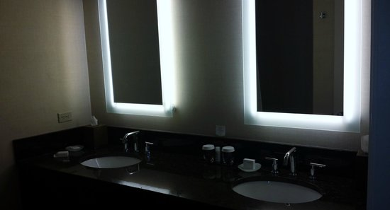 Shelburne NYC–an Affinia hotel: his and hers mirrors and sinks