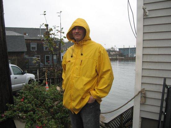 Inn on the Harbor: Hubby in much needed rain gear!