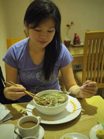 Hanoi Victory Hotel: Wife enjoying the Pho Bo