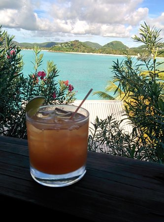 Cocobay Resort: our welcome rum punch w/ our first view of the hotel