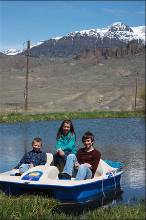 Rand Creek Ranch : Paddle boating on our Pond
