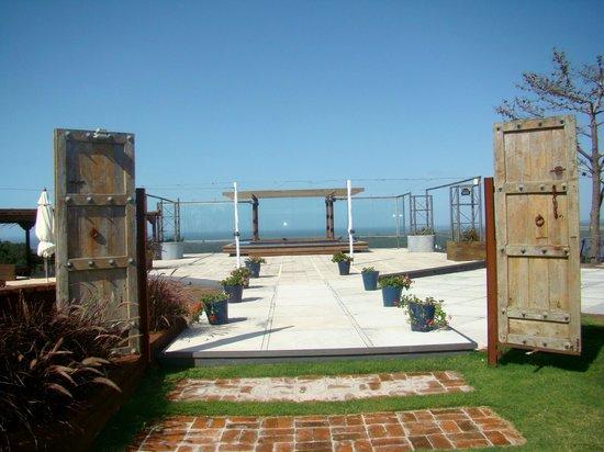 Hotel Art & Spa Las Cumbres : área externa para eventos proxima a piscina