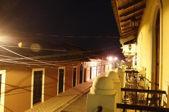 Hotel Terrasol: View of the street from the balcony at night.