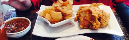 Famous City Bistro : Broasted chicken with sweet baked beans and fresh potato chips