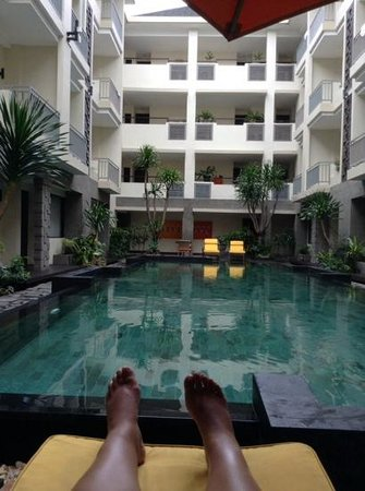 The Sunset Bali Hotel: picture of the pool and my feet