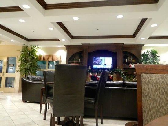 Ramada Weyburn: Fireplace and TV in breakfast room