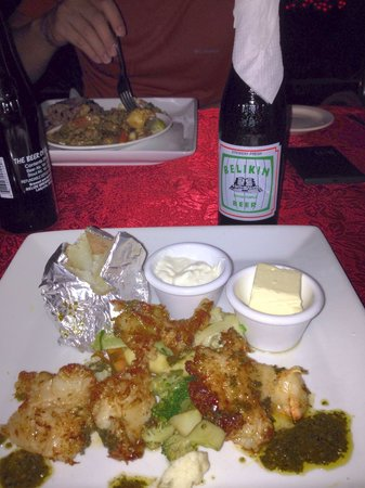 Smoky Mermaid : Grilled Conche Steak with baked potato and beer.