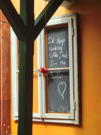 Village Café : Slogans on the wall to make the place more cosy