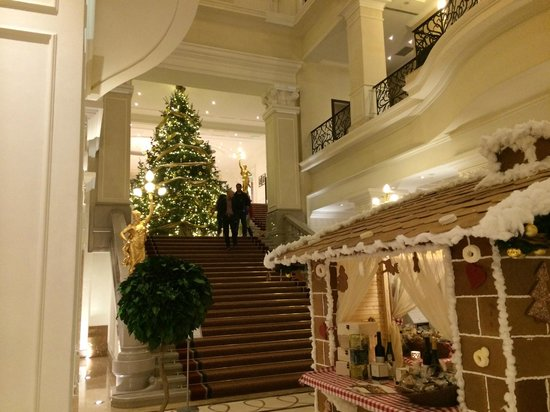 Corinthia Hotel Budapest: Lobby with gingerbread house and two story Christmas tree