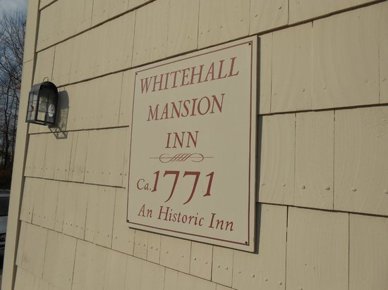 Whitehall Mansion Inn: wall plaque outside entrance