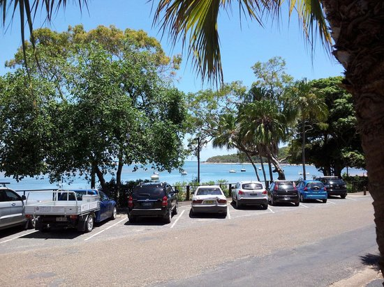 The Tree Restaurant: Only a narrow road and a few parked cars separate the most stunning calm blue waterways