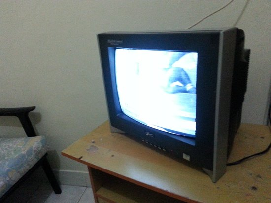 Ang's Hotel: small, broken tv.