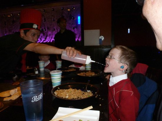 Fuji Sushi & Steak House : My six year old son gets to chug water - the adults got Sake.