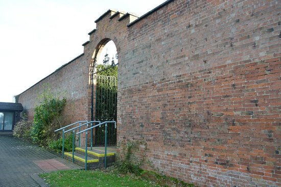 Wall at bottom of garden