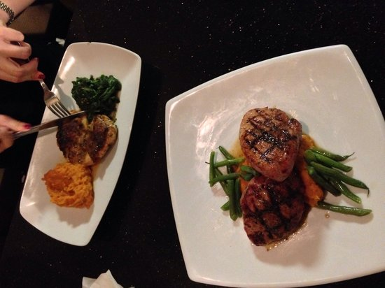 Savion's Place: Top chicken breast stuffed with delight!  Bottom infused Pork loin grilled to perfection & juicy