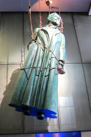 International Spy Museum: The statute on top of the entrance elevator