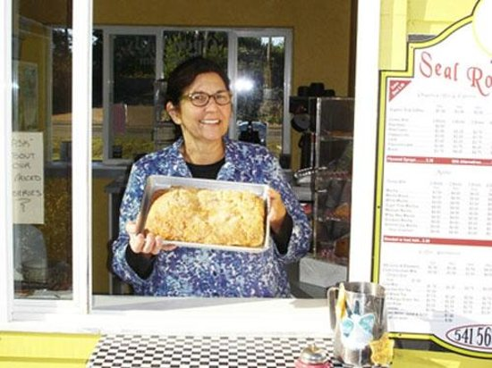 Seal Rock Espresso & Bakery: Owner Judy holding a freshly baked apple strudel. Sold whole or by the slice.