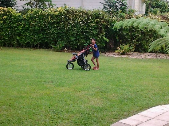 Riverside Samoa: My daughter pushing my son around in the big yard.