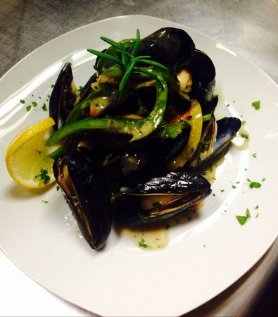 Pomodoro Grill : P.E.I. Mussels steamed with tri-color bell peppers, finished with a fresh rosemary orange liqueu