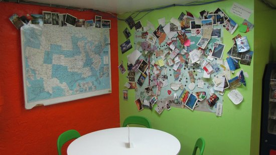 Apple Hostels Philadelphia: A maps of places people are from in the hostel basement where the kitchen and dining are located