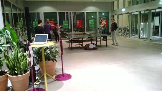 25hours Hotel Zurich West: Entrance to hotel - Table tennis area with 5 tables set up on Fri night.  Cool!