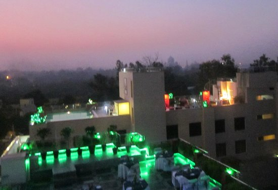 Hotel Taj Resorts: The rooftop restaurant in the foreground (green), then another hotel, then the Taj in the distan