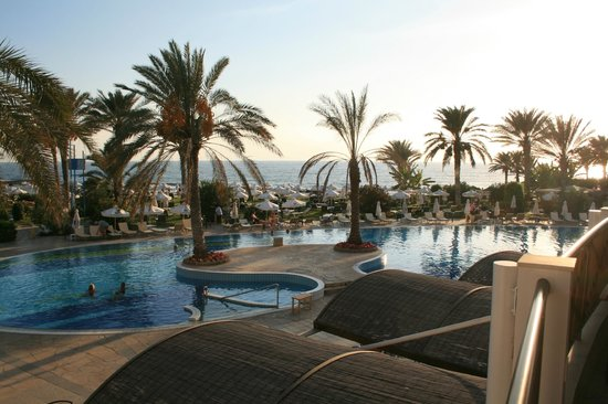 Constantinou Bros Athena Beach Hotel: View of pools looking out to sea.