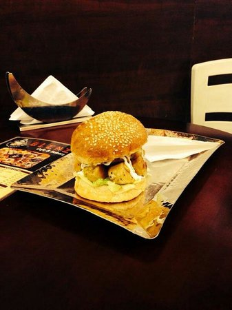 Glenz Cafe & Bakers: Mouth watering Chicken Sausage Burger only at Glenz Cafe..