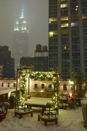 Refinery Rooftop: Snowy view of the Empire State Building & outdoor deck