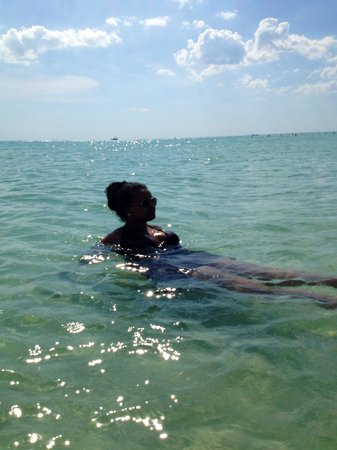 Lido Beach: As you can see, my best friend is a few feet deep into the water and it is still clear.