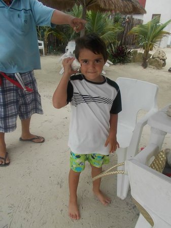 Machos Bar : My son with a shell he found. That's the owner on the left (unfortunately not a better picture!)