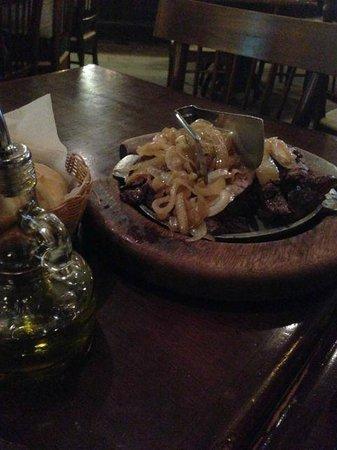 "Bom Rini: Sliced meat (Brazilian cut called ""Fraldinha"") with onions"