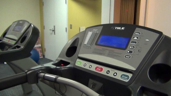 The Hotel Blue: Fitness center with one treadmill (pictured) and weight lifter.
