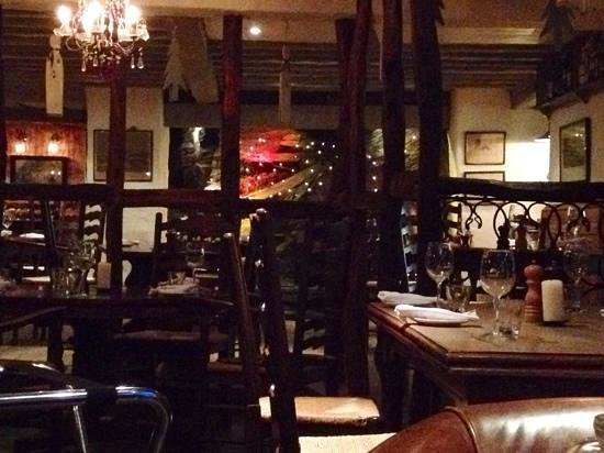 The Grill & Smokehouse Restaurant: Restaurant showing the stone bedrock and the rustic charm.